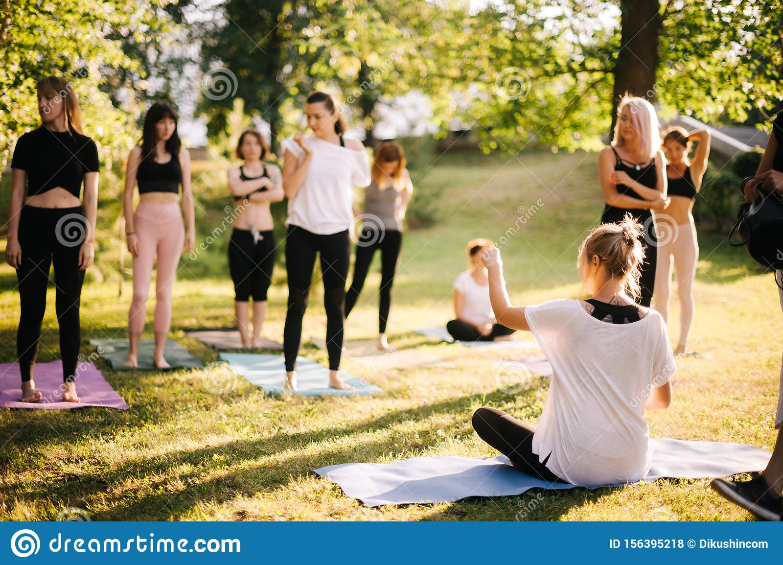 Yoga Woman Coach Welcomes His Students And Gives Instructions In Park At Dawn Stock Photo Image Of Outside Girl 156395218
