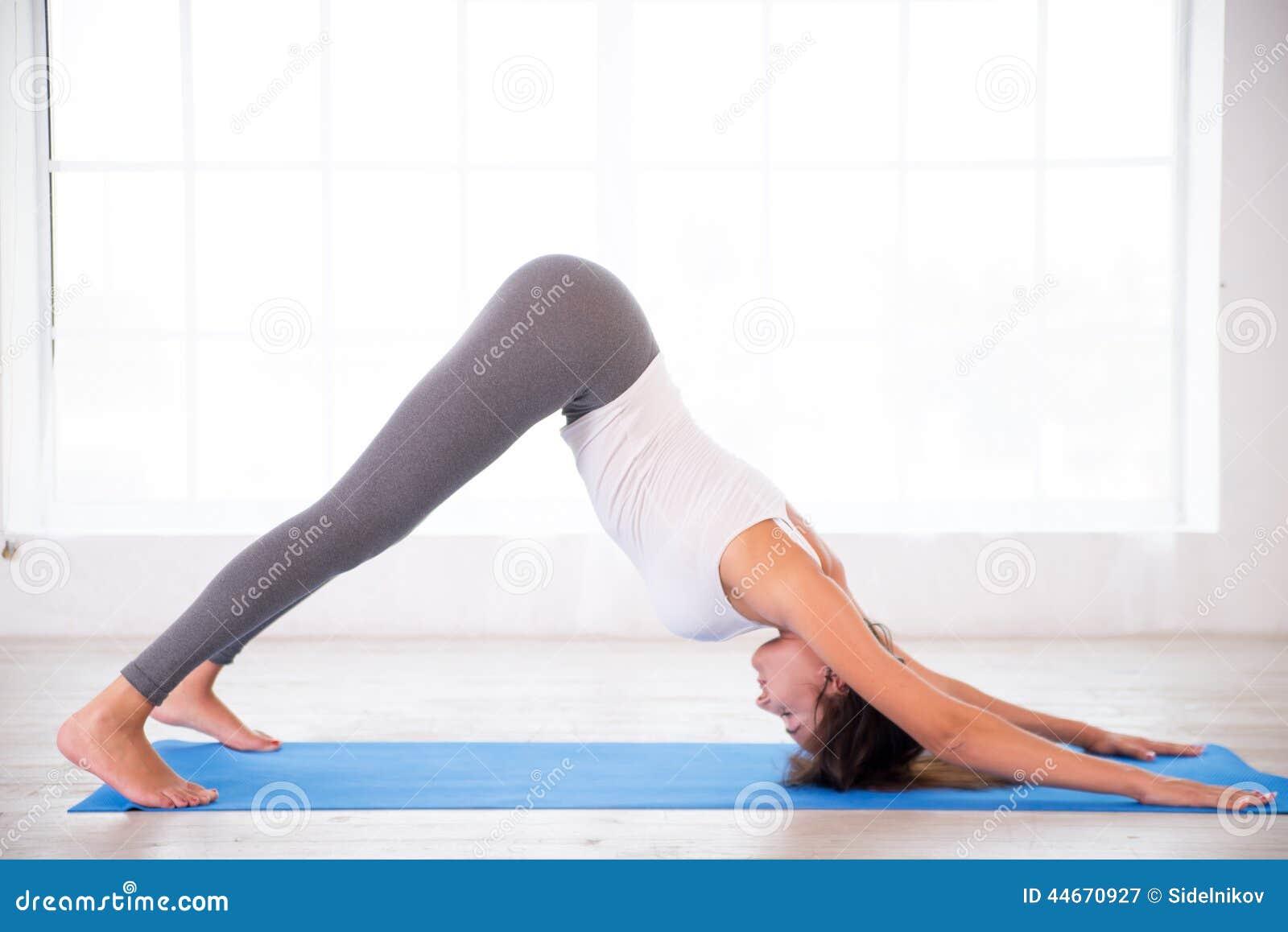 Yoga Woman Doing Down Dog Pose Stock Image   Image of indoors ...