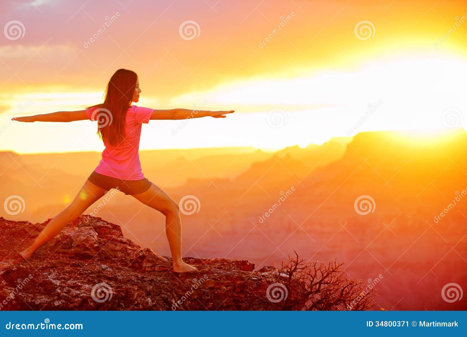 Yoga woman meditating at sunset in Grand Canyon