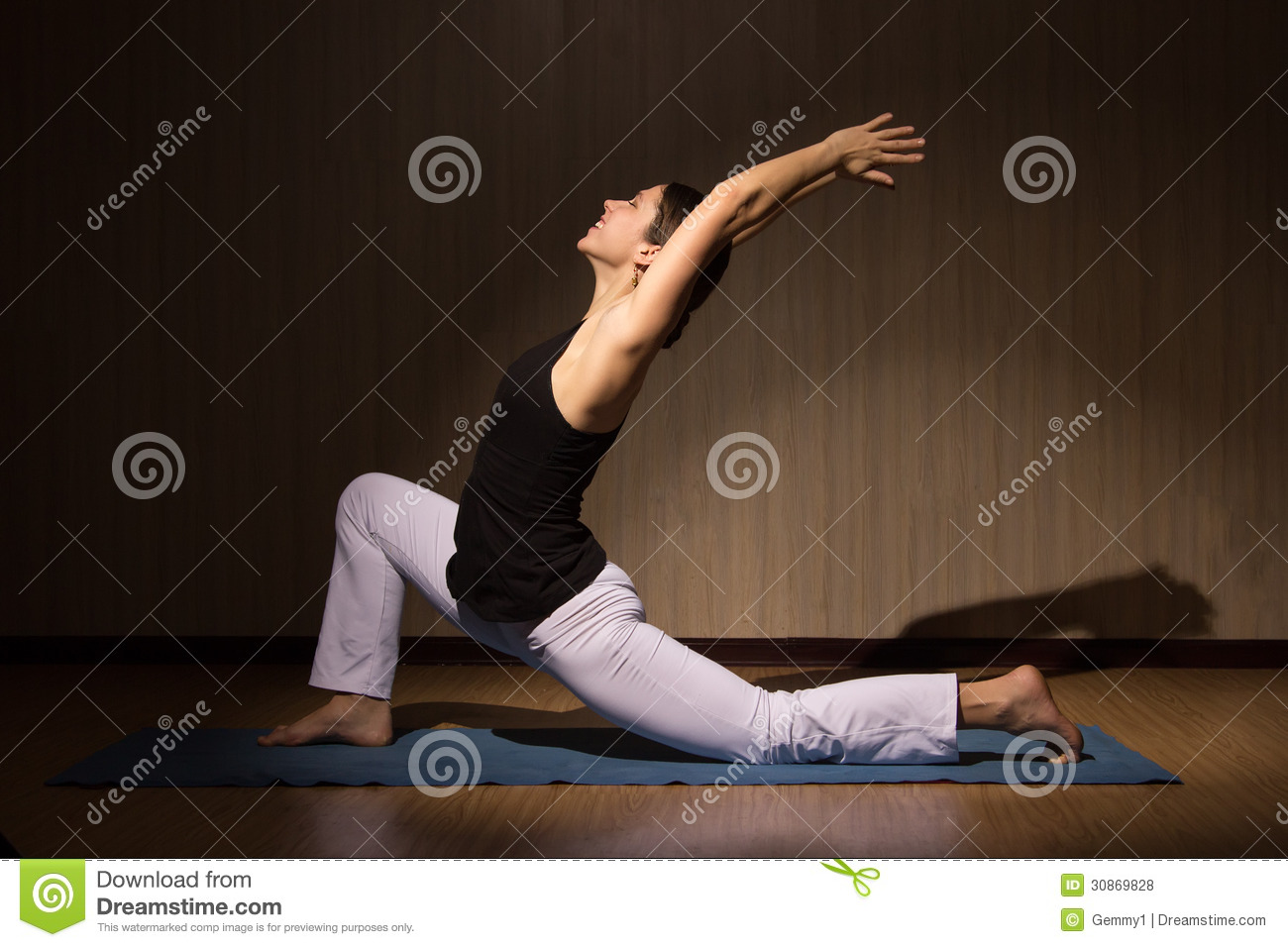Cute fit woman practising yoga in her living room royalty for Living room yoga timetable