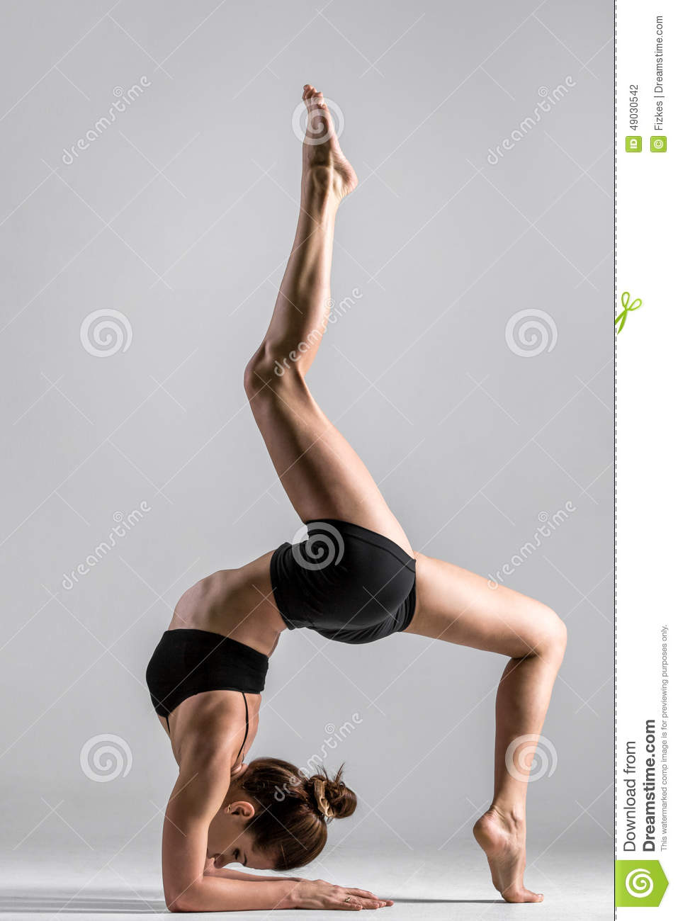 Download Yogi Gymnast Girl Performs Acrobatic Exercise Stock Photo - Image of headstand, person: 49030542