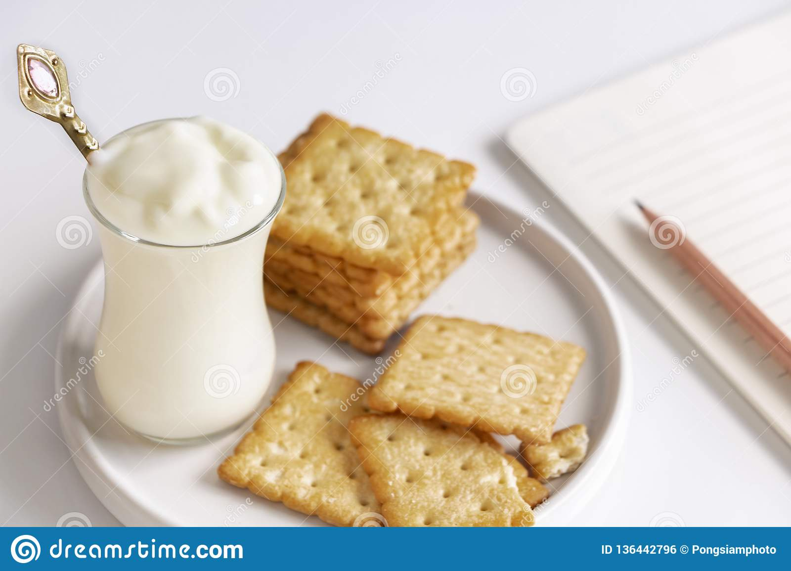 Yogurt and cookies is a healthy breakfast. Yogurt made from milk fermented by added bacteria, often sweetened and flavored