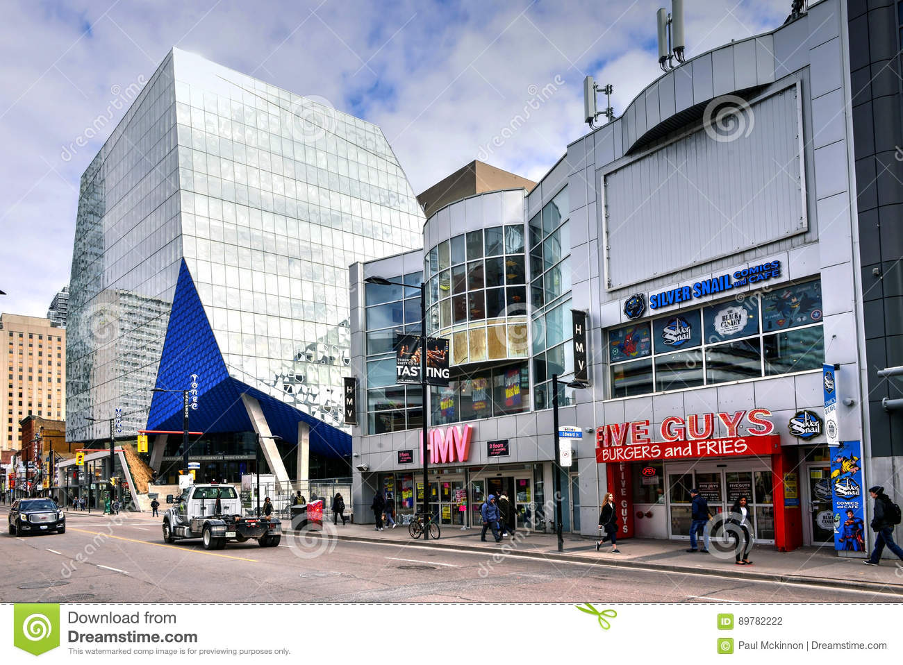Toronto Canada March 29 2017 Section Of Yonge Street Near Dundas That Includes A Five Guys Hmv With Closing Signs In Window And Glbuilding Of