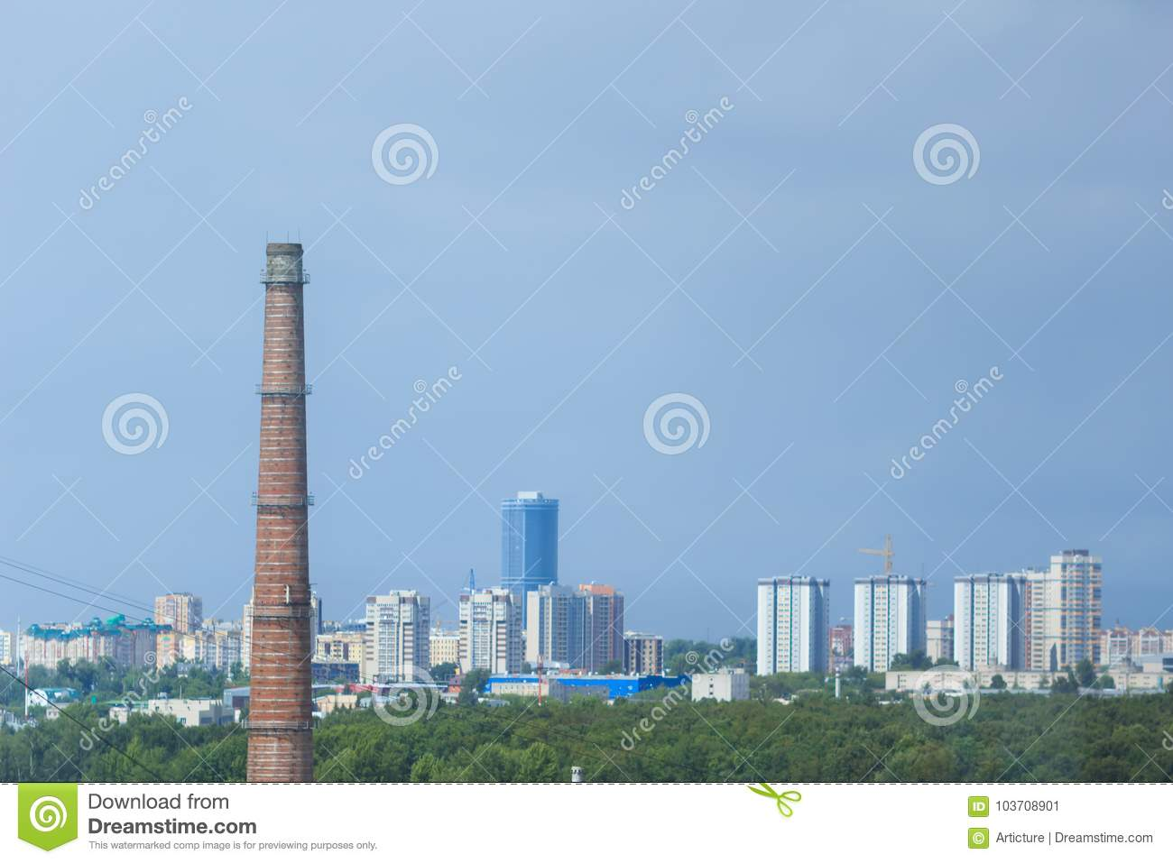 Aerial view of Kazan city. Modern buildings, greenery and old industrial pipe.