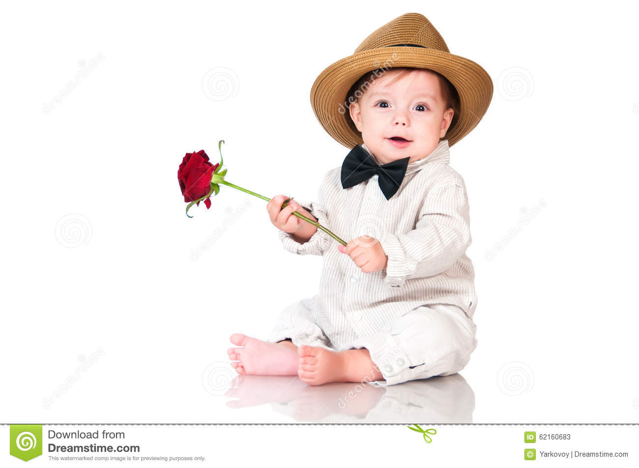 Smiling one old year boy in retro, bow-tie hat and with red rose sitting on white background.