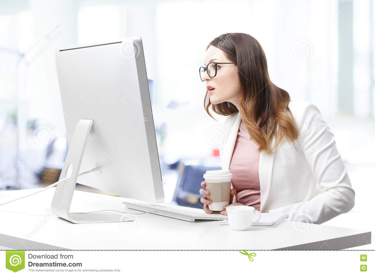 business woman scared working with computer stock