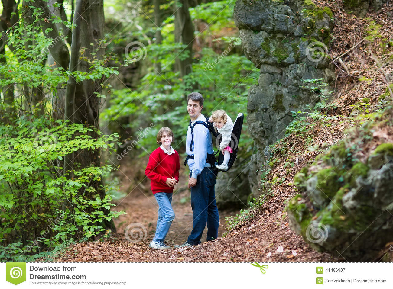 Young Active Father Hiking In Cliff And Forest With Kids