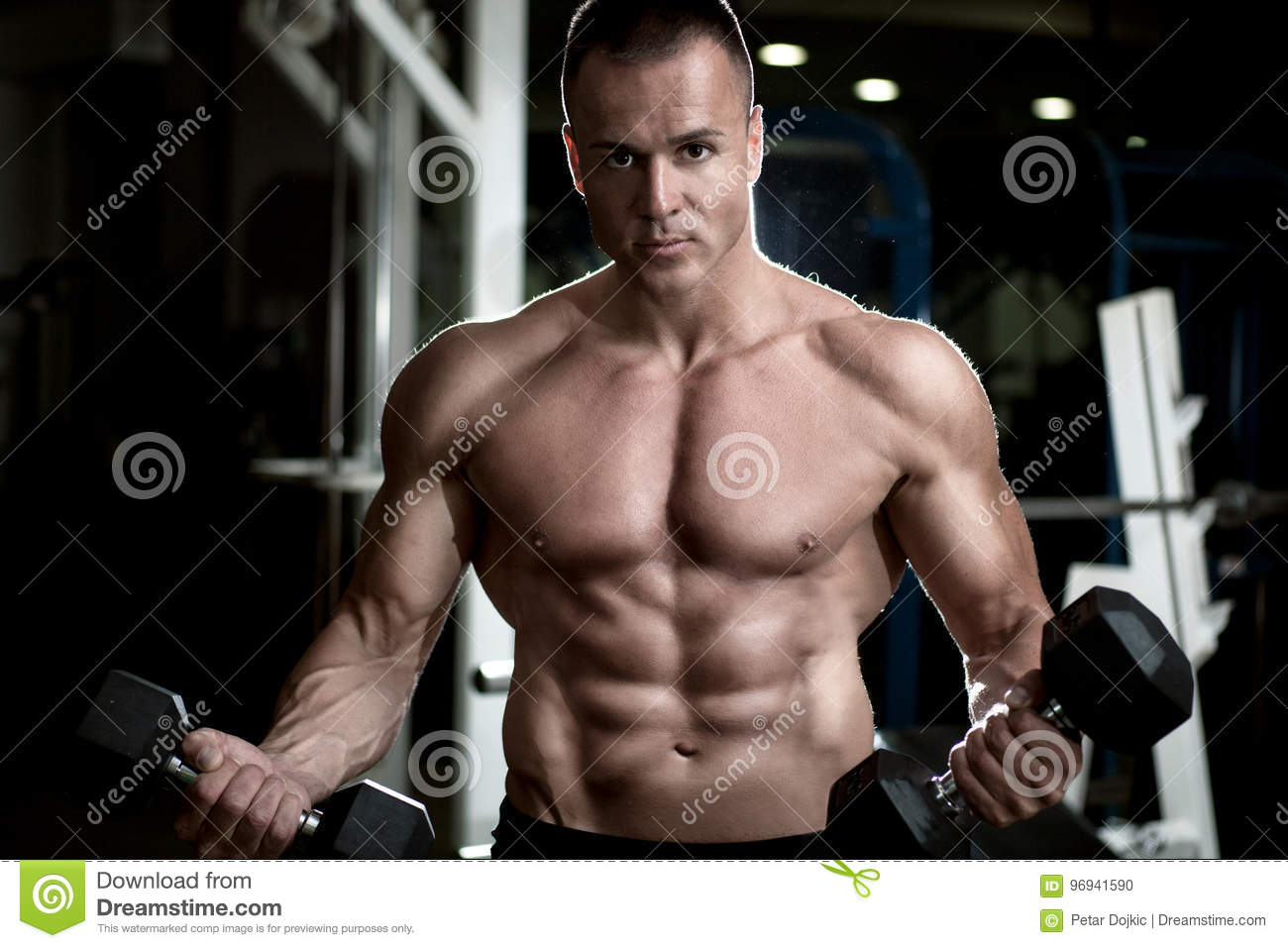 Bodybuilder Lifting Weights Stock Image - Image of