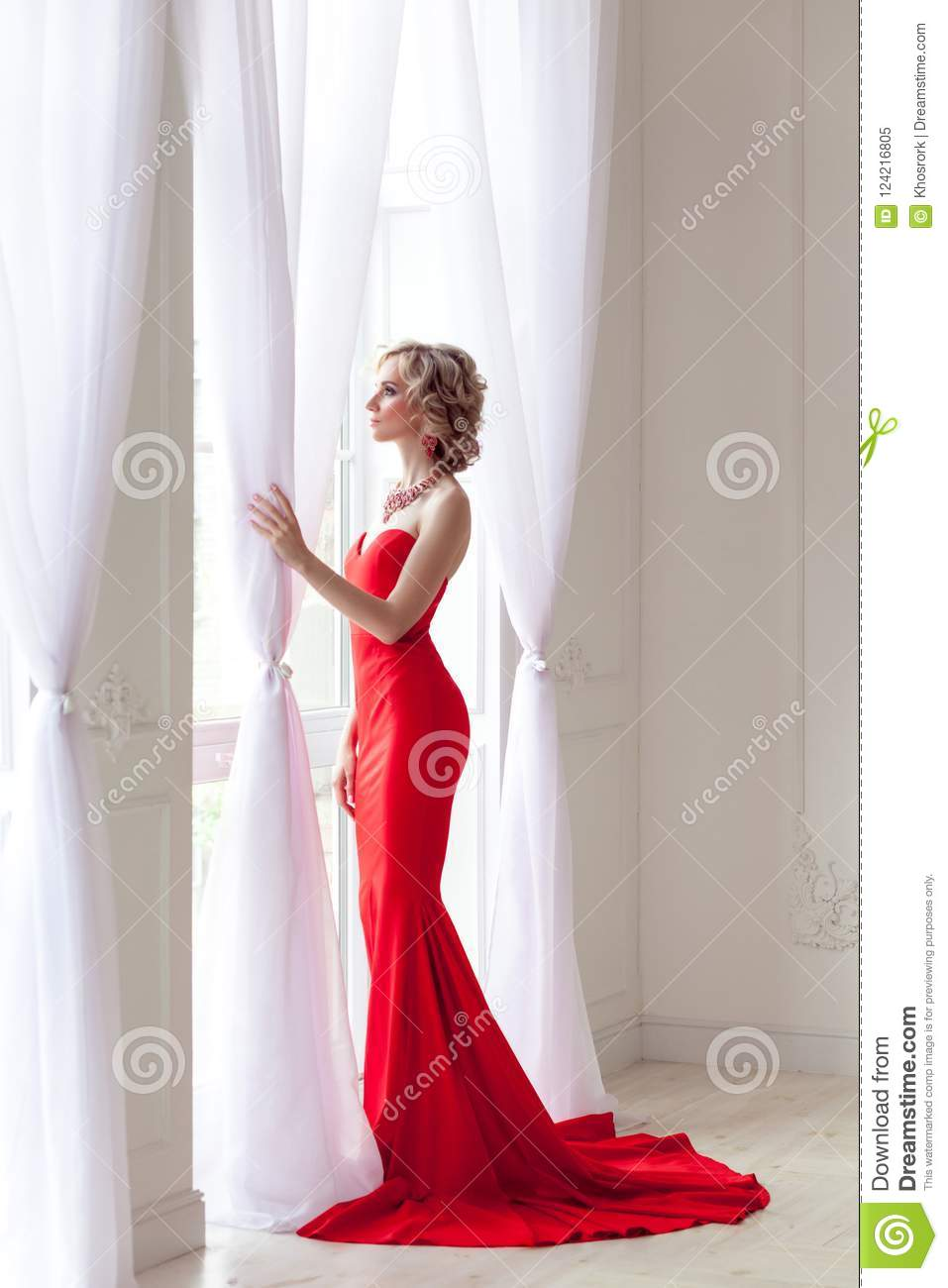 Young Adult Elegant Woman With Perfect Makeup And Red Long Dress ... 64687e4fd
