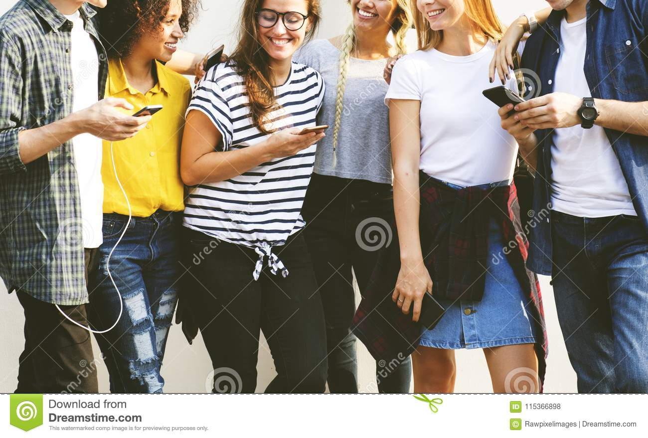 Young adult friends using smartphones together outdoors youth cu
