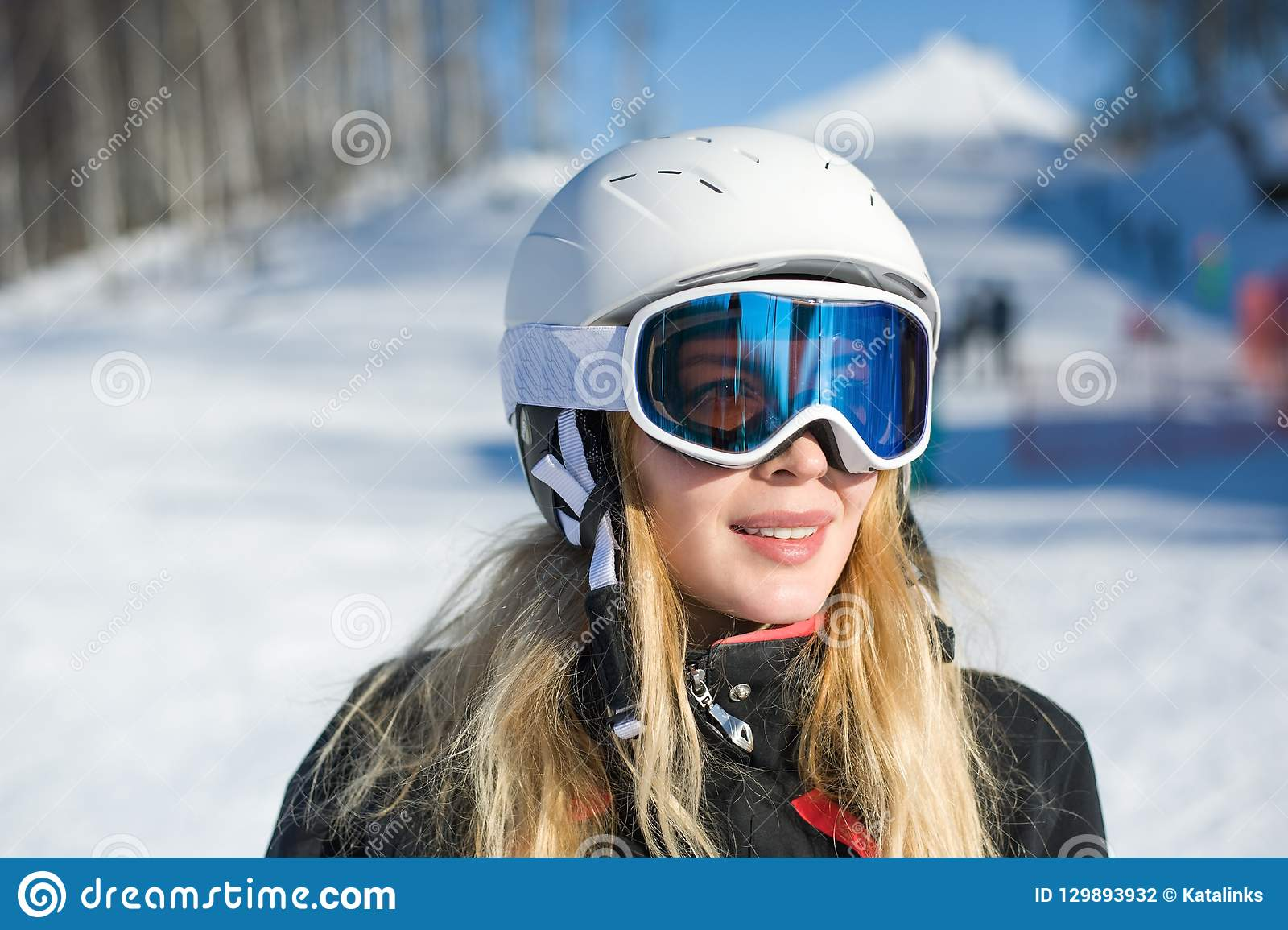 33086342850 Young adult woman snowboarder or skier in snow winter on the mountainside  the ski mask or goggles reflect the mountains