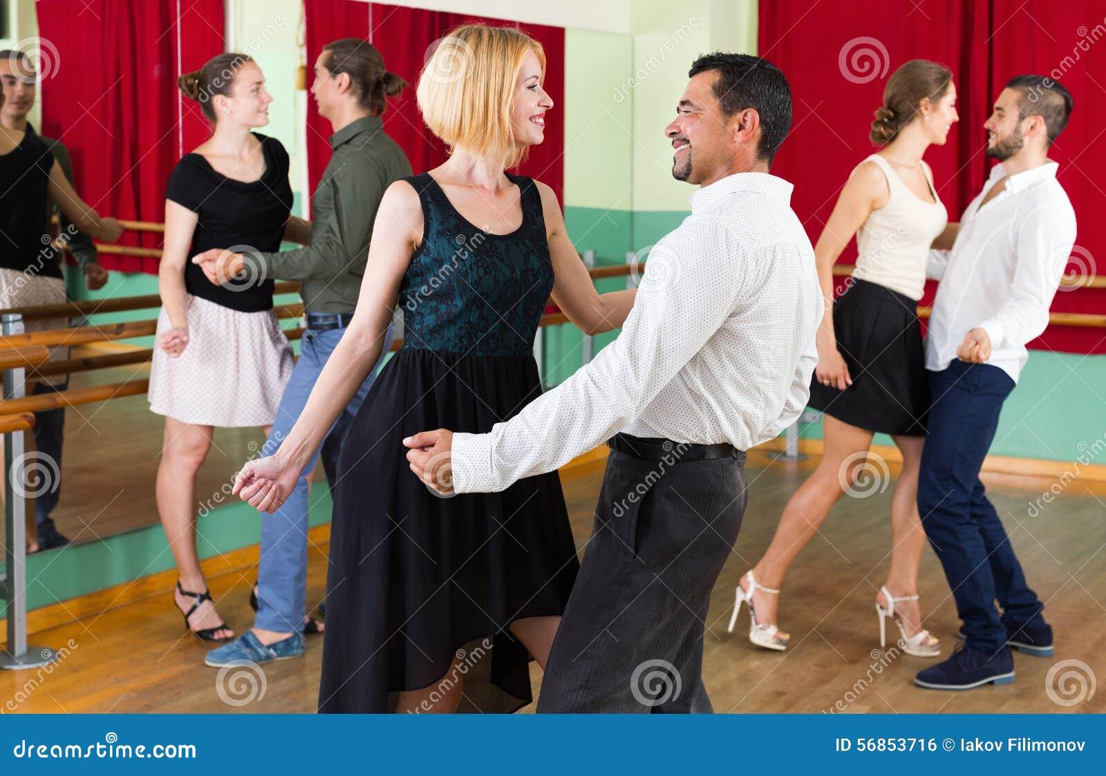 Young adults having dance class