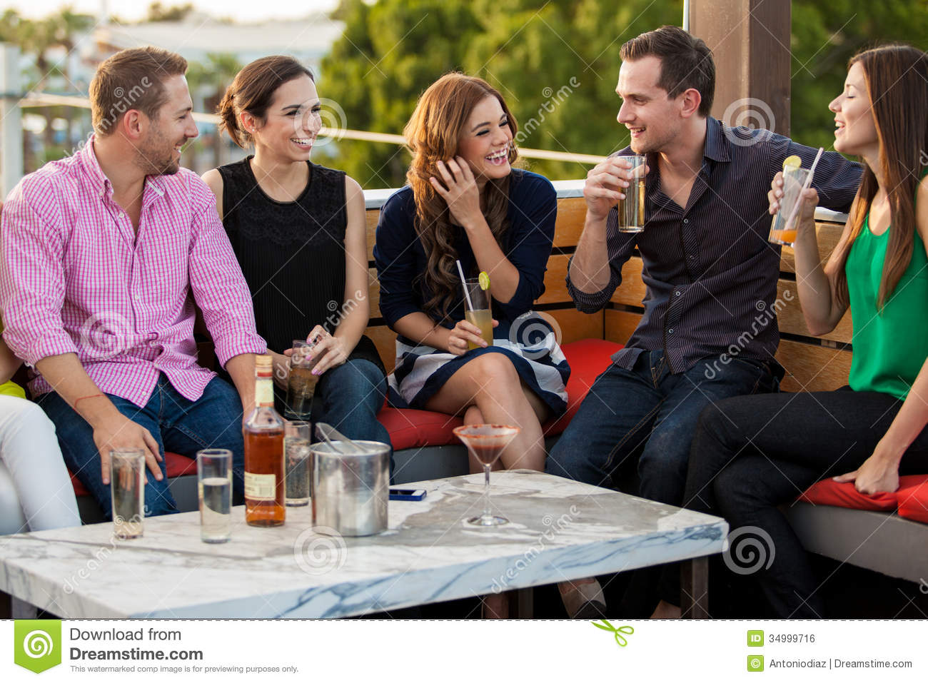 Young Adults Having Drinks At A Bar Stock Photo - Image of ...