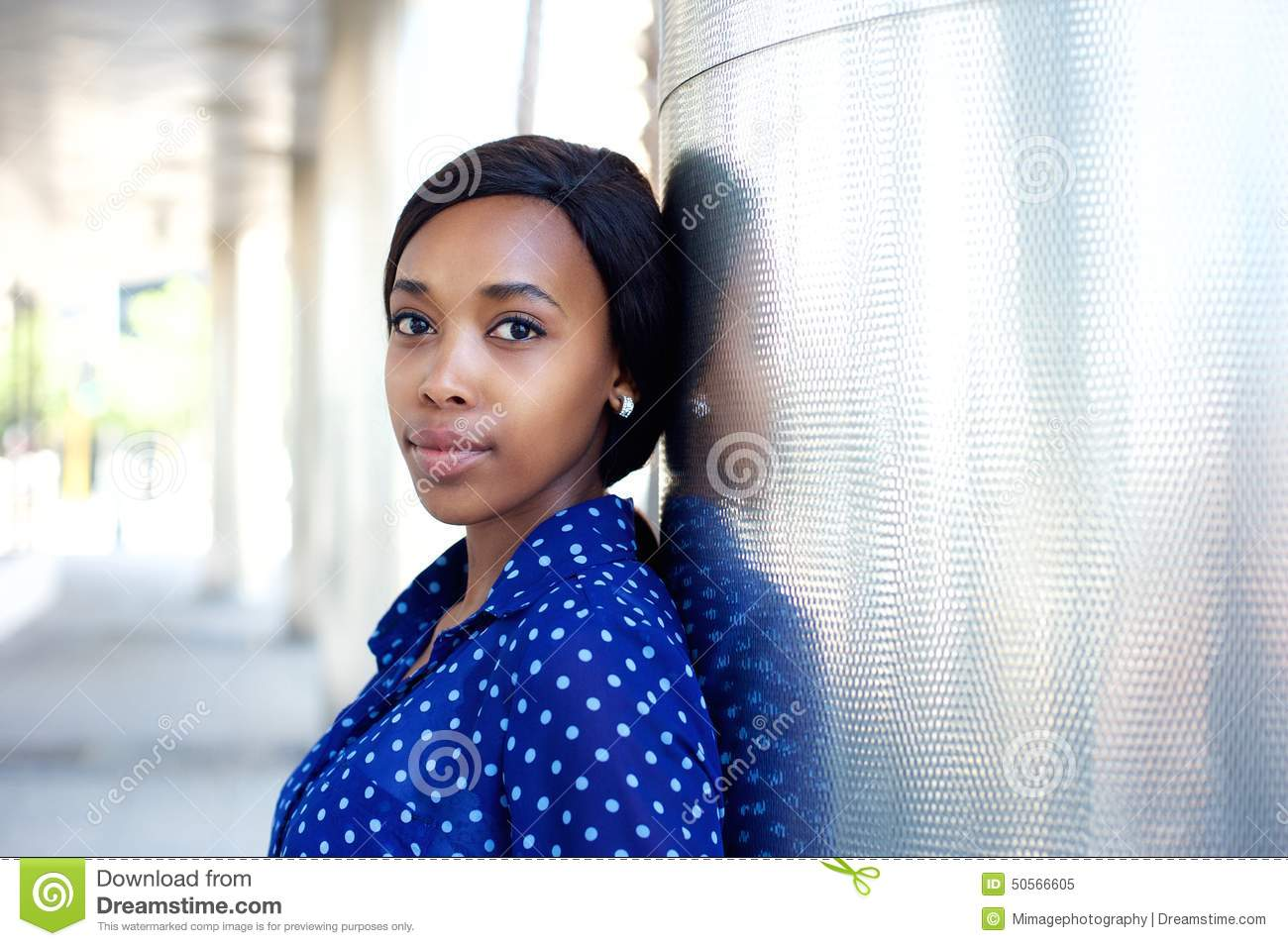 Young african america business woman in blue shirt