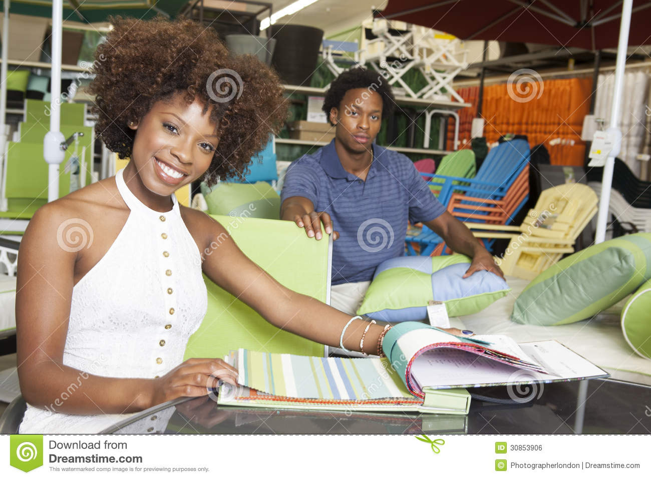 Young African American Couple Buying Outdoor Furniture At Store Stock Photo Image Of Counter