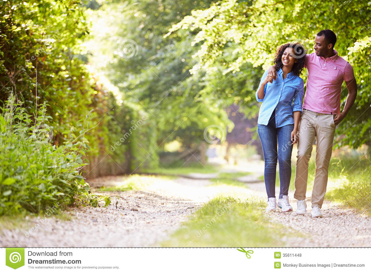 Young African American Couple Walking In Countryside Stock ...