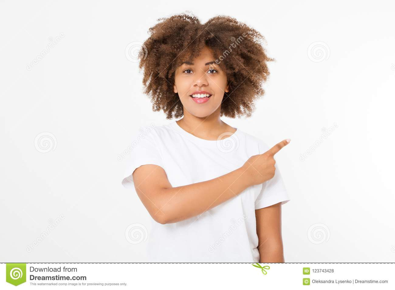 Young african american happy woman showing copyspace pointing on isolated white background. Template, blank shirt. Afro hair
