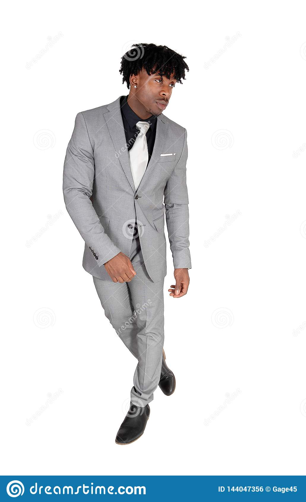 Dancing black man in a gray suit with fussy black hair