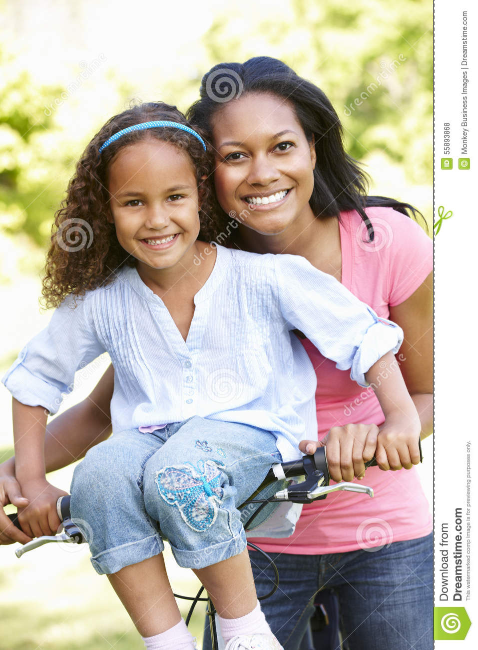 Young African American Mother And Daughter Cycling In Park ...