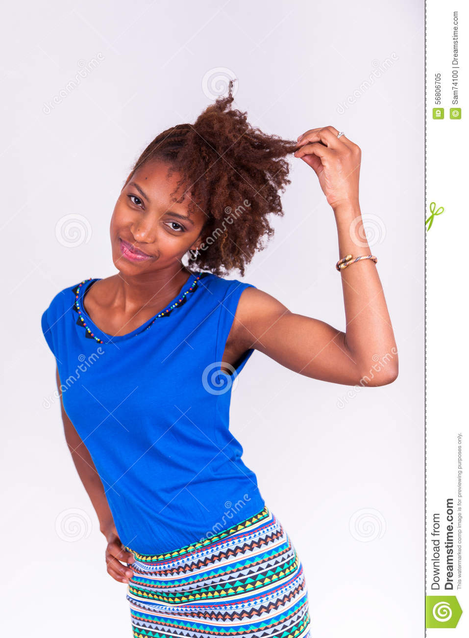 Young African American woman holding her frizzy afro hair - Blac
