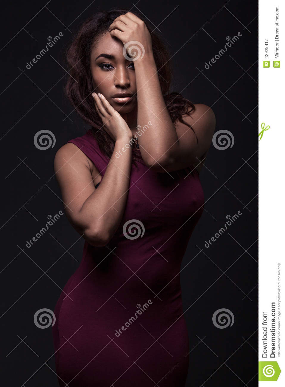 Young African American Woman Wearing Red Dress Stock