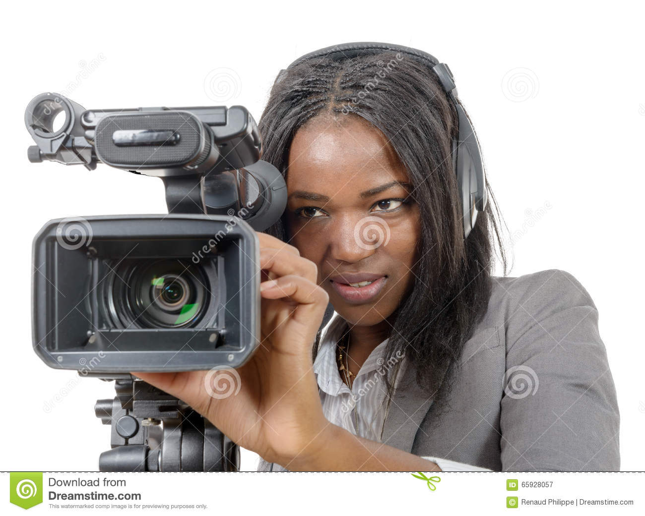 A young African American woman with professional video camera and headphone e3d9976a6b
