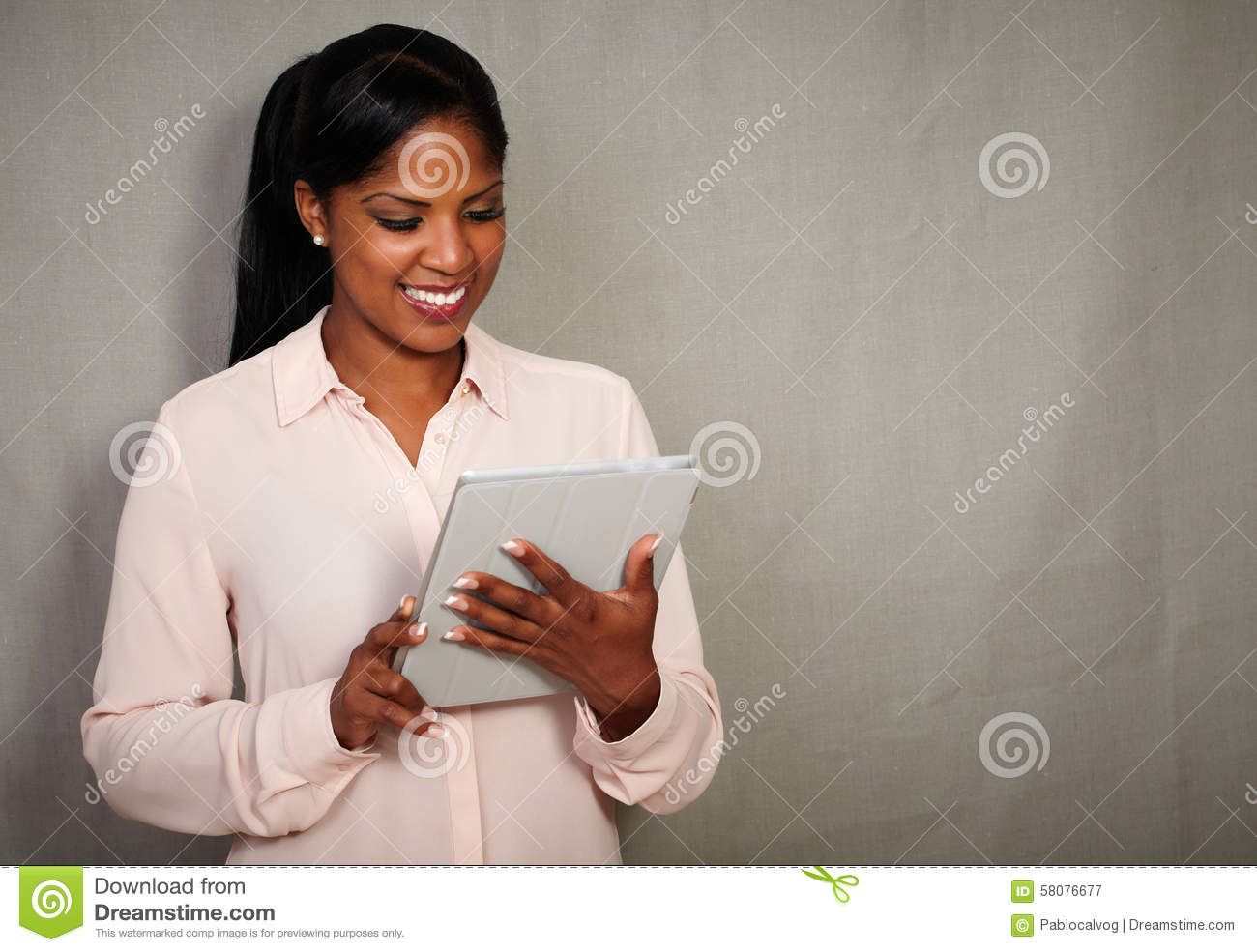 Young african businesswoman holding a tablet