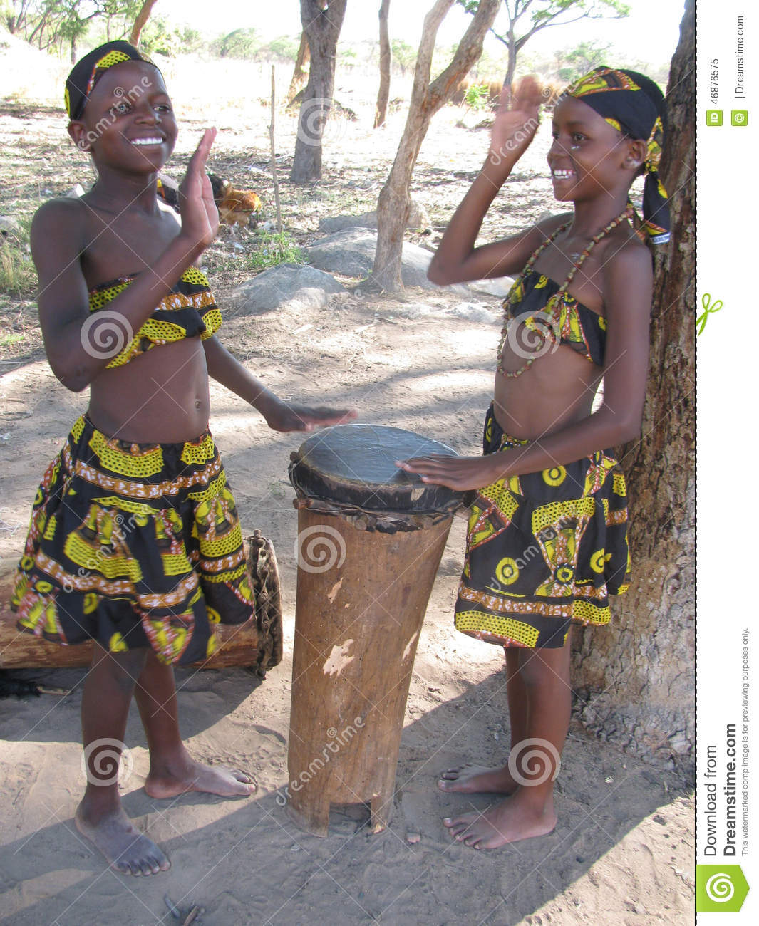 Young African Girls In Cultural Attire Playing Drums Editorial Image