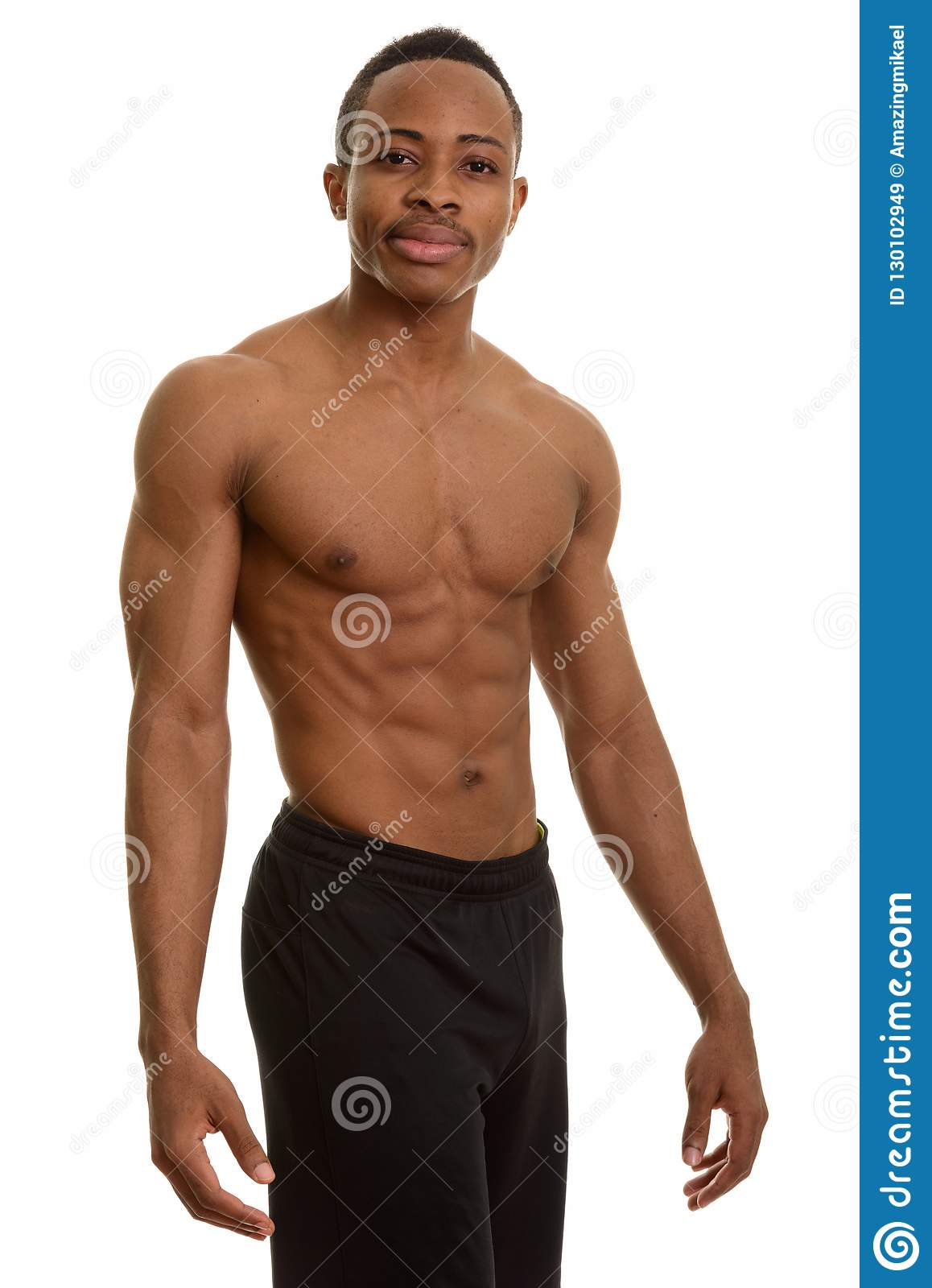 Studio Shot Of Young Handsome Man Shirtless Isolated