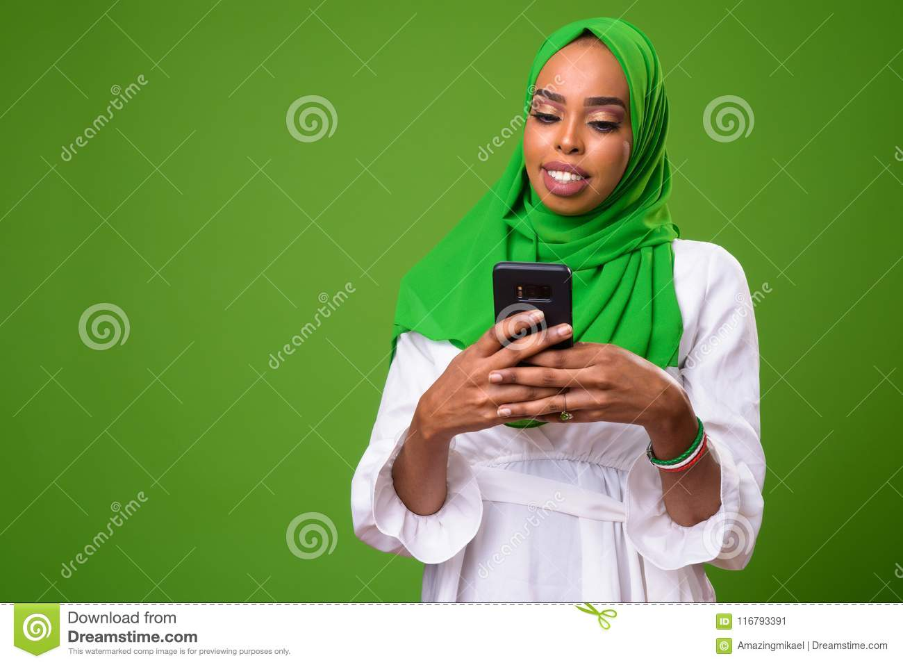 Young African Muslim Woman Against Chroma Key With Green