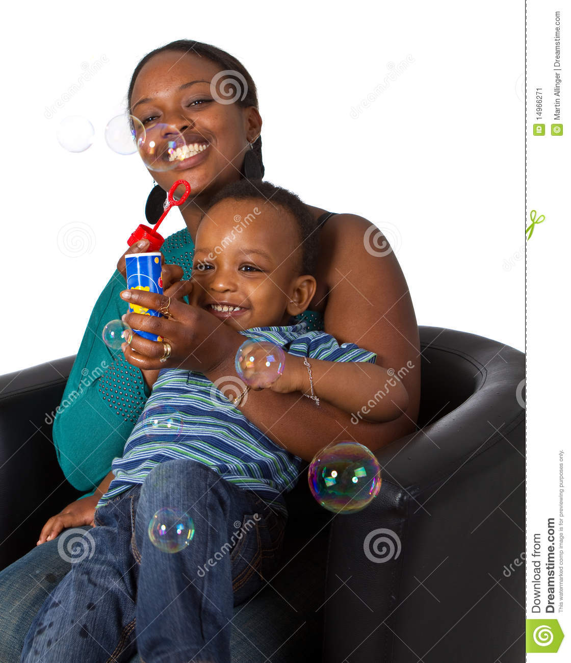 Young afro american family with bubbles