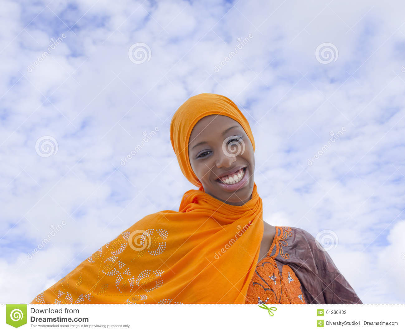 Young Afro beauty wearing a traditional headscarf in the street