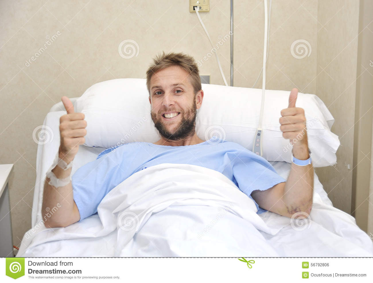 young american man lying in bed at hospital room sick or ill but giving thumbs up smiling happy patient hospital bed clipart boy in hospital bed clipart