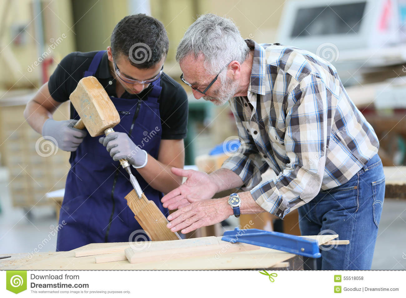 Young apprentice in carpentry with instructor