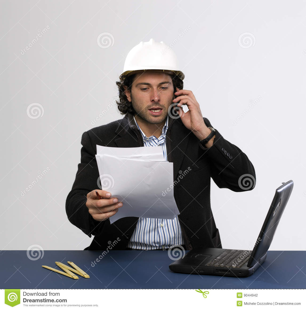 Young architect at work stock photography image 9044942 for Architect at work