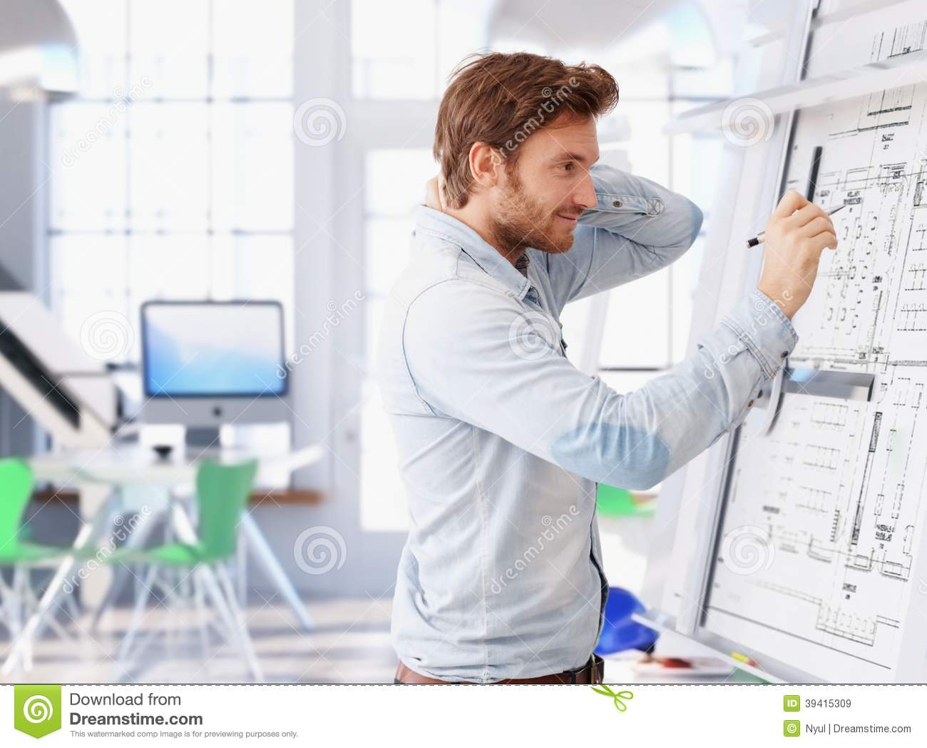 Young Architect Working At Drawing Board Stock Photo