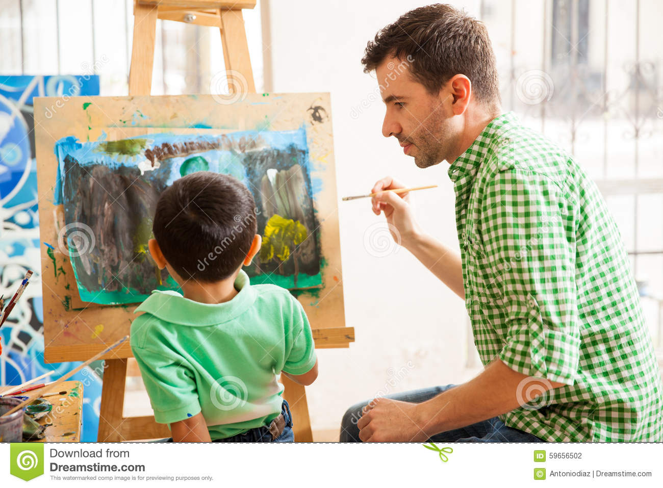 young art teacher doing his job stock photo image of learning