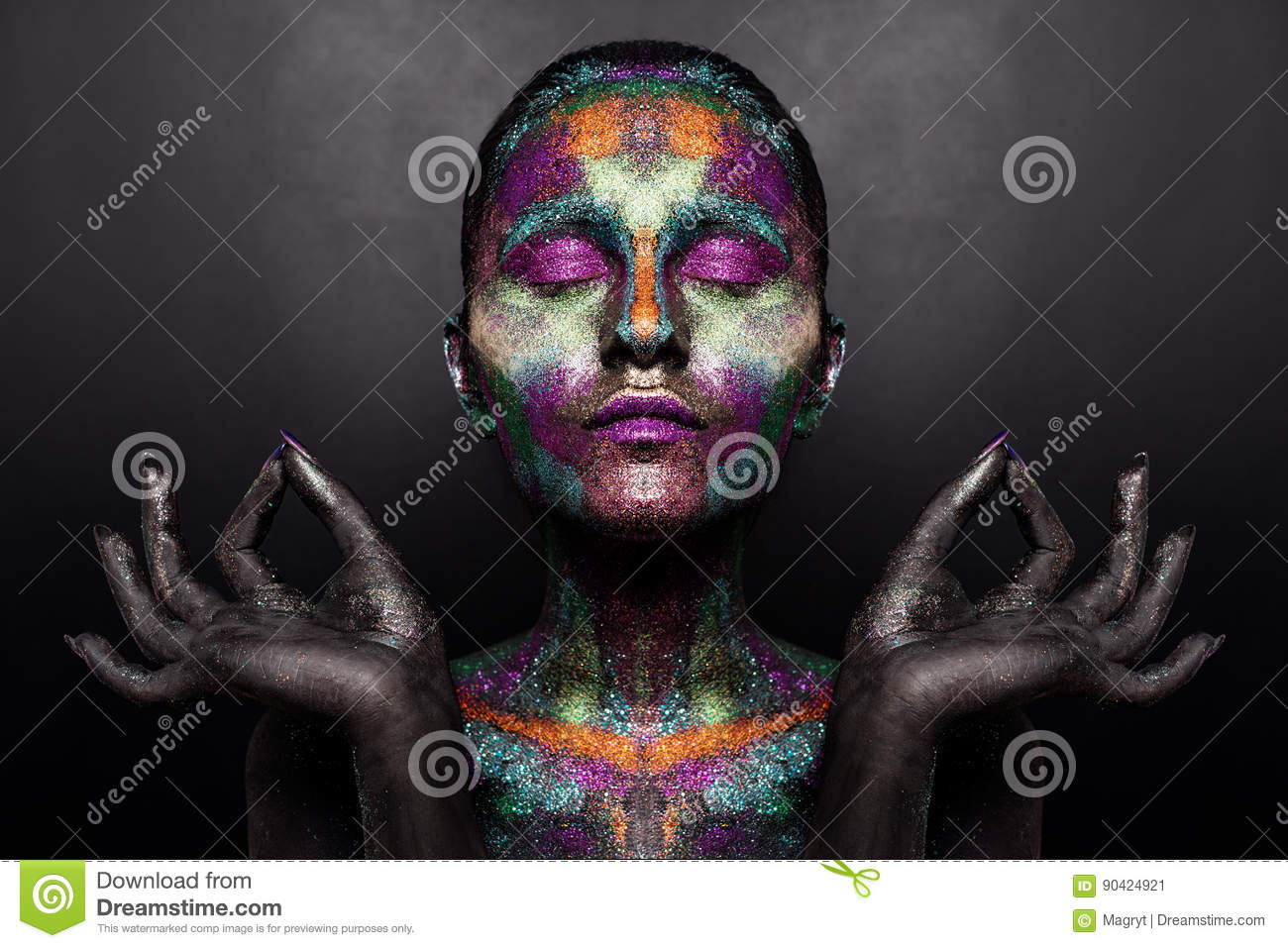 Young artistic woman in black paint and colourful powder. Glowing dark makeup. Creative body art on the theme of space