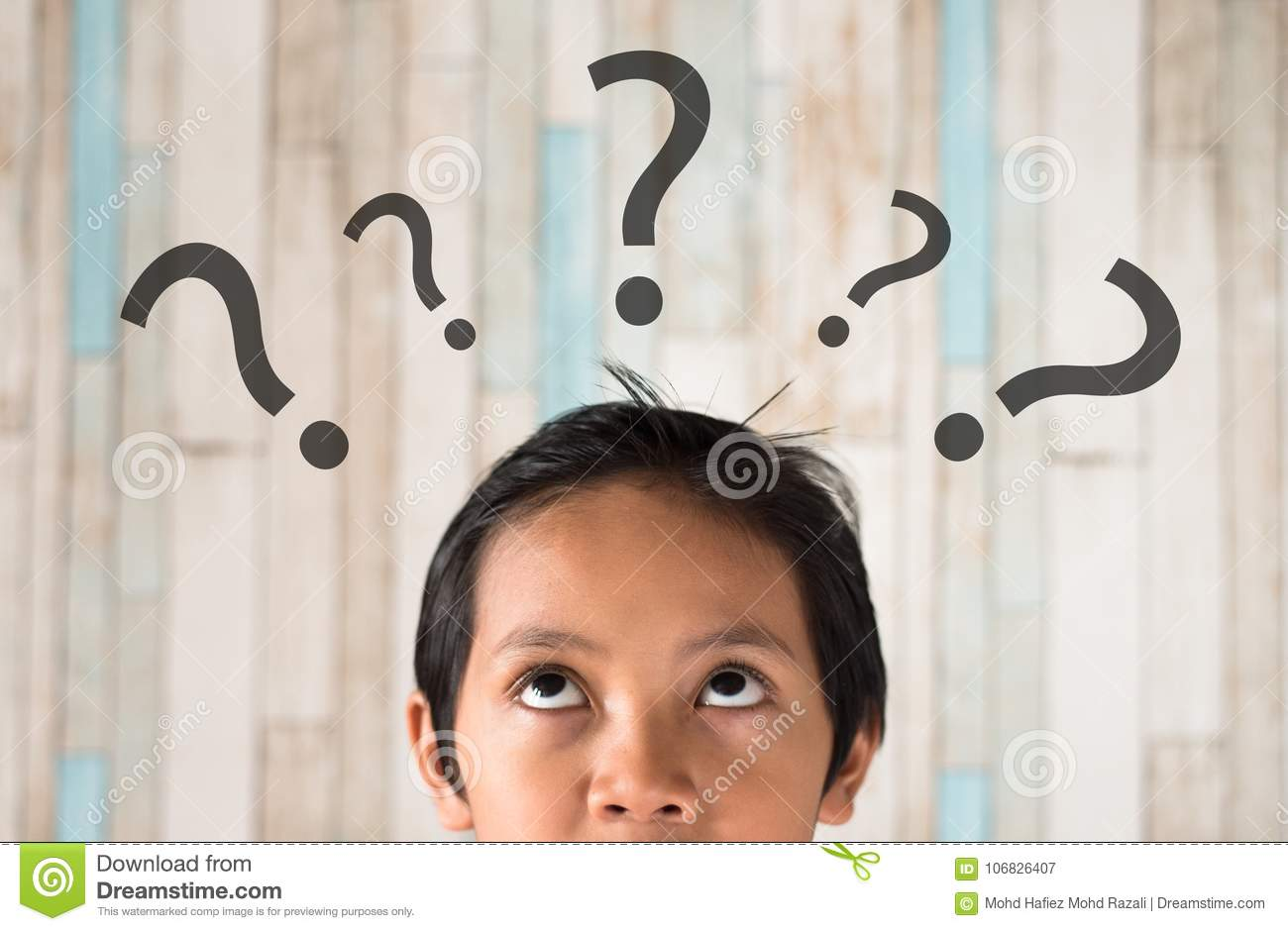 Young asian boy looking at question mark