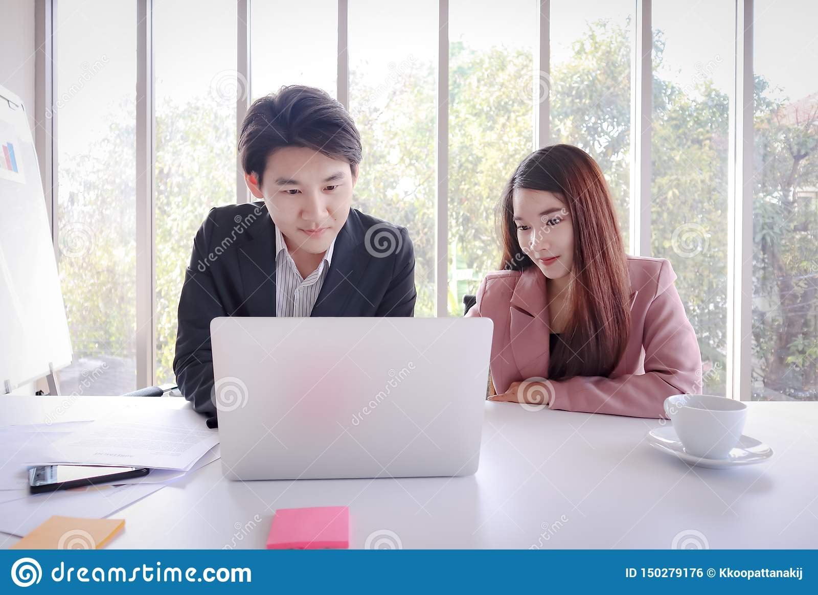 Young Asian business man work with laptop in the office