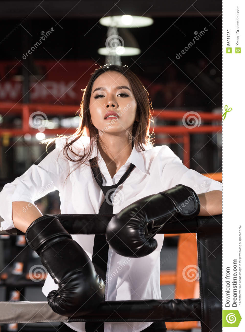 Young Asian businesswoman with boxing glove,Tiredness