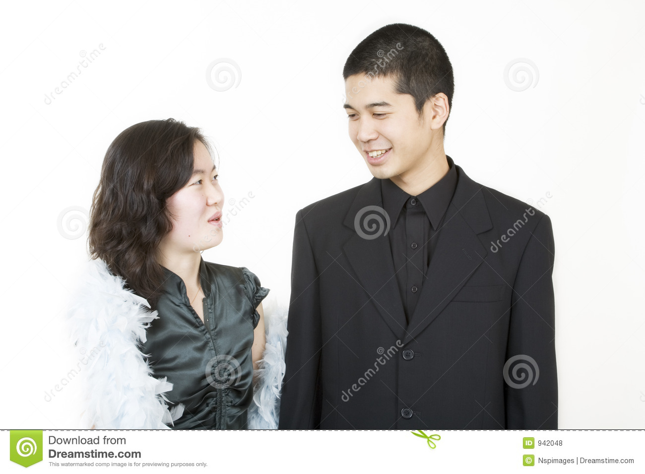 Young asian couple dressed up