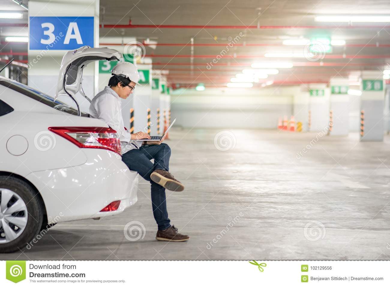 young asian engineer working with laptop on car trunk stock photo image of engineer. Black Bedroom Furniture Sets. Home Design Ideas