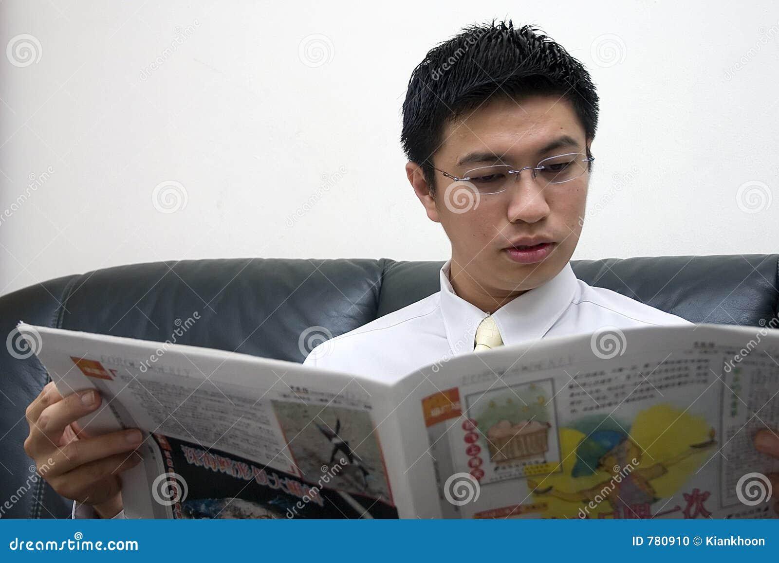 Young Asian Entrepreneur Reading