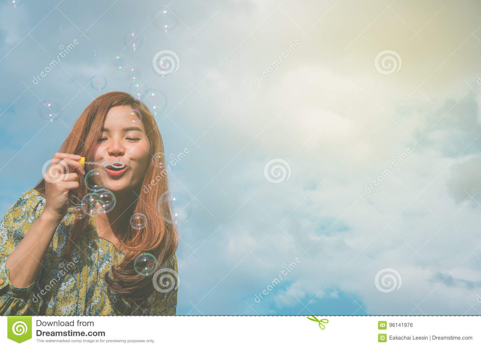 Asian girls blowing
