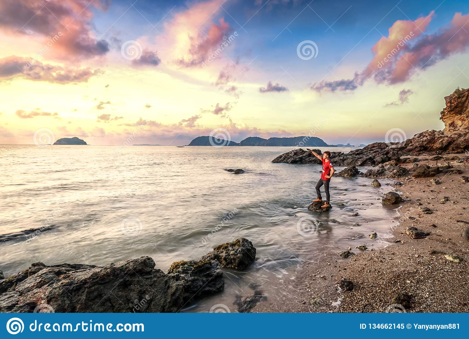 Lifestyle image of happy person at secluded beach