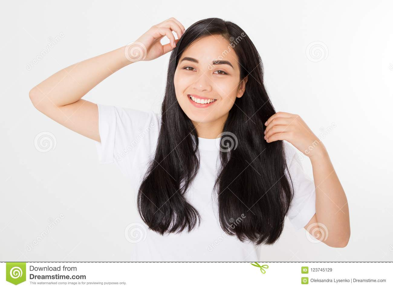 Young asian woman with brunette healthy clean shiny hair isolated on white background. Girl long hairstyle. Copy space.
