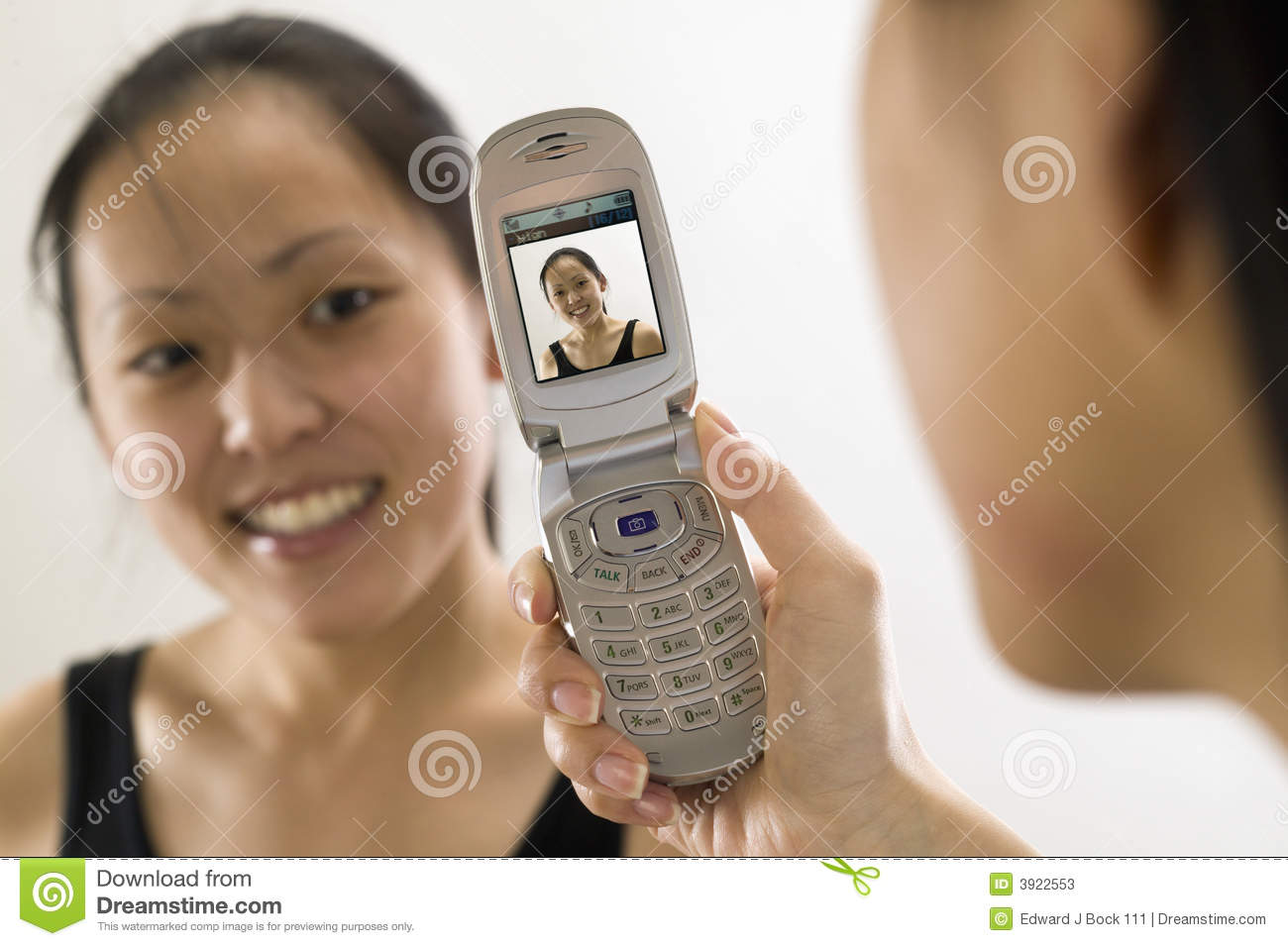 Young Asian woman with cell phone