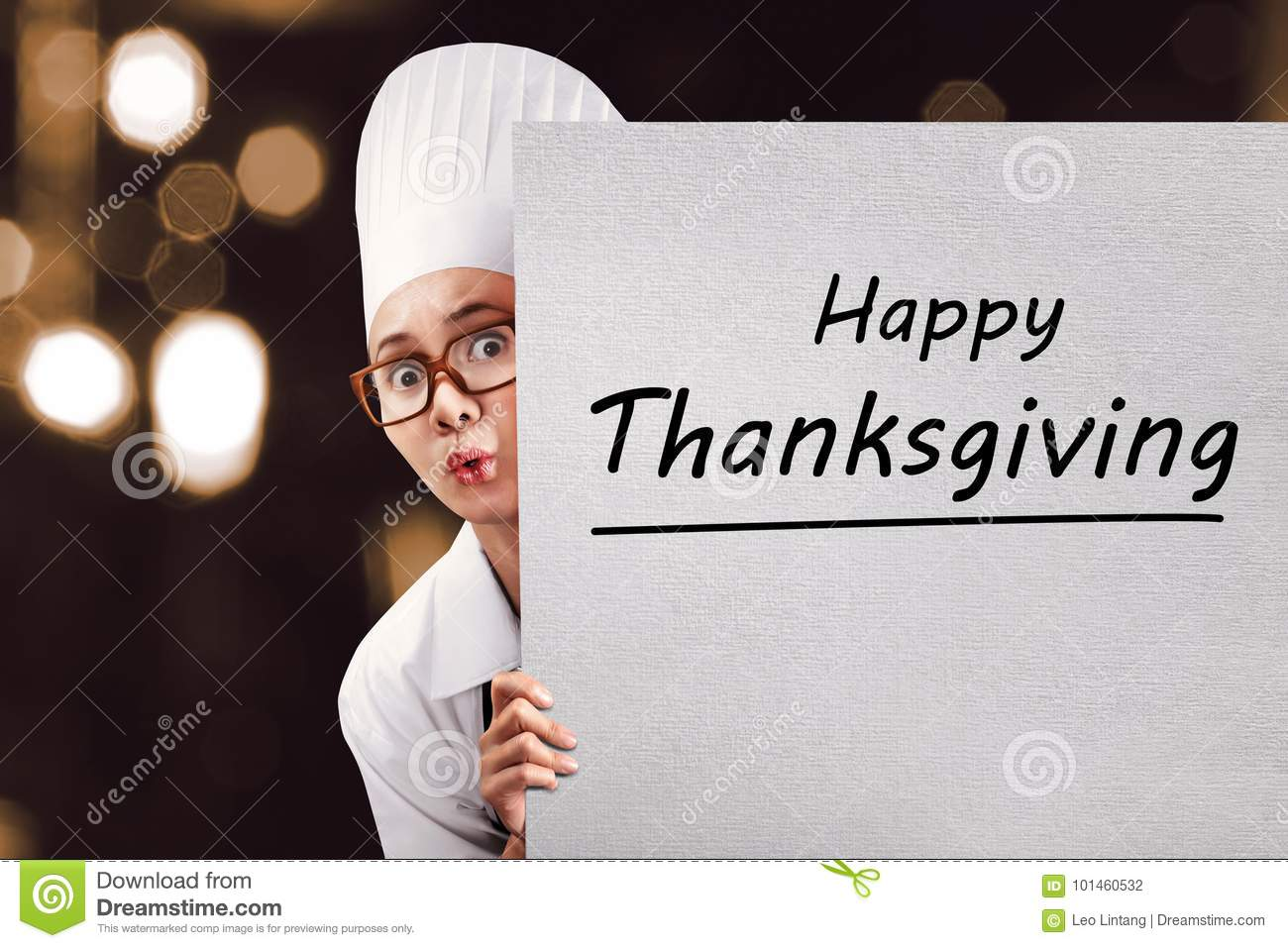 Young asian woman chef with Happy Thanksgiving message