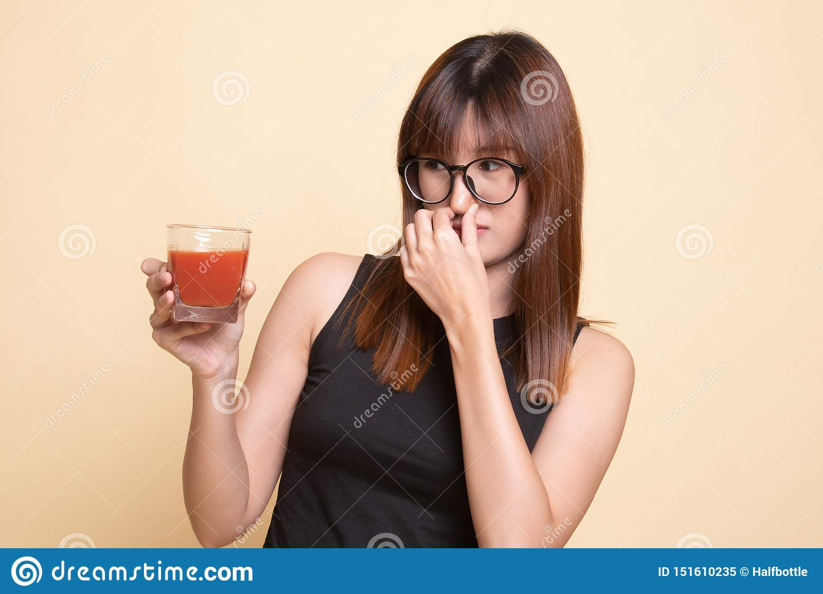 Young Asian Woman Hate Tomato Juice Stock Image - Image of